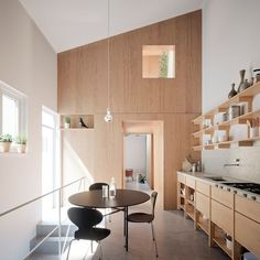 White walls and light wood make a clean minimal kitchen stand out