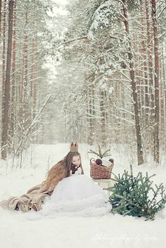 Little snow princess in the forest