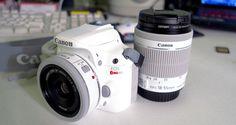 "White Canon Rebel SL1 mounting a white Canon 40mm ""pancake"" lens, adjacent the white Canon 18-55mm ""kit"" lens.  http://ehowton.livejournal.com/tag/camera"