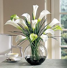 white flowers in a glass clear vase