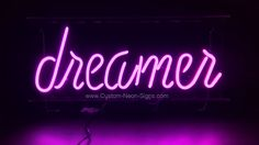 dreamer neon sign with script lettering in orchid pink neon.   Visit our web site for more information on our custom neon signs .