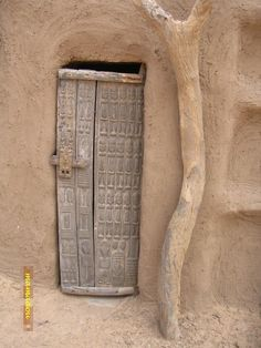 It is one of Africa's most interesting regions. Dogon people have old and rich cultural heritage: masks, dances, carving and pueblo-like dwellings. Escarpment where Dogon live is 150 km long. Cool Doors, Unique Doors, Portal, Porte Cochere, Entrance Doors, Doorway, When One Door Closes, Knobs And Knockers, Door Gate