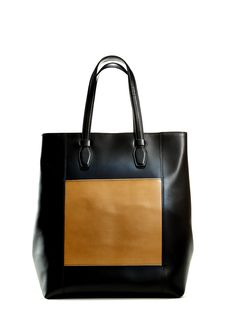 Seeing double. We love this two-toned Italian leather tote handbag for its size and versatility. Brown and black pair easily with any outfit. Click through to see more fabulous handbags in our fall look book.