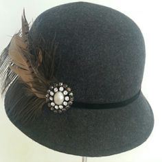Reduce Price!  Wool Felt Bucket Charcoal grey felt trimmed in black velvet band, with a beautiful pearl, stone pin. Finish of with taupe tone feathers. Adjustable band inside for a perfect fit. Callanan Accessories Hats