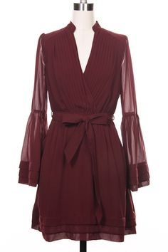 Ariana dress, with bell sleeves, and side pockets! In burgundy/wine, rose or black. www.theflauntshop.com