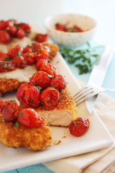 Crispy Parmesan Chicken with Balsamic Roasted Tomatoes – Crispy cutlets topped with sweet, juicy balsamic tomatoes is one of our favorite easy weeknight meals! | thecomfortofcooking.com