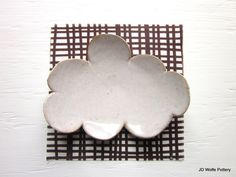 3 cloud magnets made of clay by JDWolfePottery on Etsy