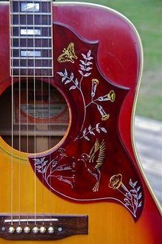 http://en.wikipedia.org/wiki/Gibson_Hummingbird  ~ Gibson Hummingbird... just like 'Mack's'