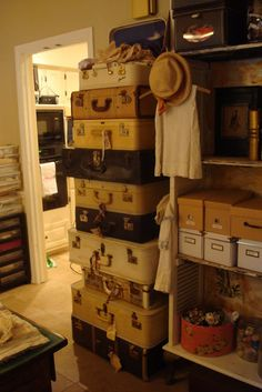 Love the suitcases for storage. Yeah, you have to move them all to get to the bottom one, but it looks great!
