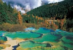 The travertine pools of Huanglong, China.
