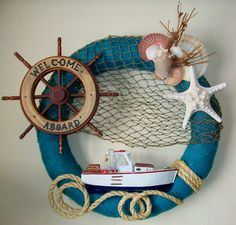 Shabby Chic Nautical Skipper Wreath Nautical Décor, Coastal Décor, Fishing Décor, Buoy Wreath, Burlap Wreath, Fishing Wreath. This wreath is a lovely palette of water colors and beach tones along with nautical favorites - captain's wheel, fishing boat and net, sea shells, and starfish.