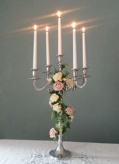 Silver Candelabra Wrapped with Roses and Ivy - Pretty! Candelabra Wedding Centerpieces, Candelabra Flowers, Silver Candelabra, Wedding Decorations, Table Decorations, Table Centers, Centre Pieces, Wedding Table, Wedding Ideas