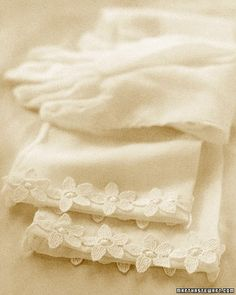 Subtly personalize a pair of elegant full-length gloves with a floral organza lace. The edging, available from fabric and notions shops, can be tacked onto the gloves using small invisible stitches in matching thread, and removed later if you wish.