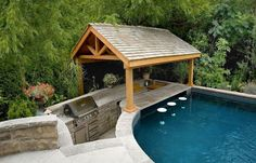 pools on a sloped lot | shelter and swim-up bar is located at the shallow end. The pool ...