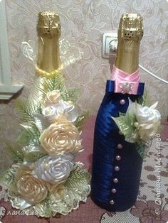 Beautiful decorated wine bottles - would make a great wedding etc gift (champers)