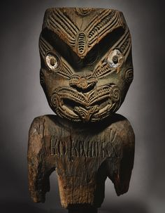 Maori Figure, Probably from a Palisade Post, North Island, New Zealand, Inscribed KU KO KAHUKANUI - Height: 29 7/8 in - This enormously commanding Maori sculpture was probably once part of the main palisade post (pou whakarae) of a Maori pā, or defensive settlement or hill fort. These settlements are primarily found in the North Island of New Zealand, & the carving style of this sculpture is consistent with such an attribution. ~ Auction estimate: $200,000 - $300,000 USD Polynesian People, Tiki Head, Tiki Statues, Facial Tattoos, Tiki Lounge, Tiki Tiki, Maori Art, Ocean Art, Aboriginal Art