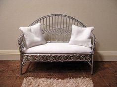 Silver settee with white cushioned seat and two pillows - dollhouse miniature. $30.00, via Etsy.