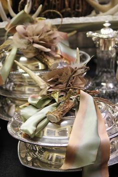 Silver vegetable serving pieces re-purposed as lunch boxes with fall embellishments on top! Imagine serving a box lunch in them.