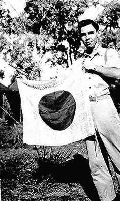 Woody J. Cochran holding a Japanese flag in New Guinea - Cherokee - 1943 {Note: As a Bomber Pilot during World War II, Lt. Cochran was awarded the Distinguished Flying Cross; the Silver Star, the Purple Heart, and the Air Medal. Native American Cherokee, Cherokee Nation, Native American Tribes, Native American History, Native Americans, American Art, The Silver Star, Interesting History, First Nations