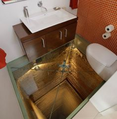 Glass-floor-toilet/bathroom/powder room in a penthouse apartment in Guadalajara, Mexico. Built over an unfinished elevator shaft that goes down 15 stories. Reinforced glass, of course. Luxury Penthouse, Glass Floor, Mirror Floor, Bathroom Toilets, Glass Bathroom, Funny Bathroom, Washroom, Bathroom Vanities, Wood Bathroom