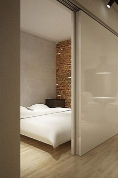 Sliding door separating the master bedroom from the living room, Loft project by Justyna Balczewska
