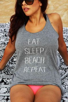 """Eat Sleep Beach Repeat Racerback Tank Top Lounge on the beach with a heather gray women's very soft and comfortable racer back tank with a white """"Eat Sleep Beach Repeat"""" print. Printed on 50% polyester/25% combed ring-spun cotton/25% rayon, 32 singles, 4.3 ounce tri-blend tank. Extremely soft, comfortable and stretchy. *Please reference our women's size chart for approximate dimensions. Beach Tanks, Beach Shirts, Vacation Shirts, Vacation Outfits, Summer Outfits, Cute Outfits, Beach Outfits, Summertime Outfits, Travel Shirts"""