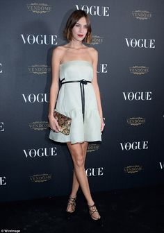 Simple and elegant:Alexa Chung  let her hair down at the Vogue Paris Fashion Week party o...