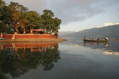 Nepal, Pokhara, boat on Pokhara Lake, sunset