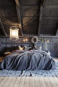 cozy barn loft bedroom with rustic feel and lots of wood beans and wood panels