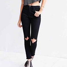 BDG Black Ripped Jeans Black BDG brand jeans with two holes in the knee. Perfect condition, bought from another posher & they're too big for me. Make me an offer! BDG Jeans Skinny