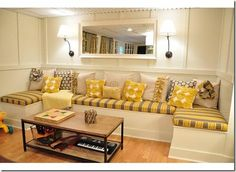 This amazing built-in banquette really caught my eye, along with the fresh yellow and gray fabrics.
