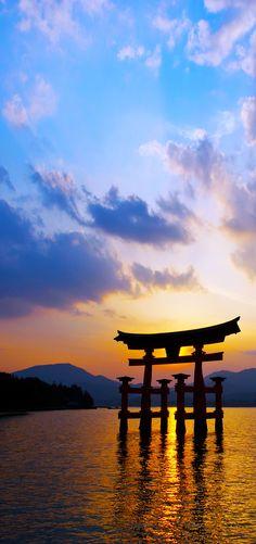 Itsukushima Shrine with Miyajima Torii silhouette at dusk. | 19 Reasons to Love Japan, an Unforgettable Travel Destination