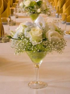 Giant Martini glass centerpieces may not be a new concept, or a clever one, but personally, I like them. The design possibilities are endless...