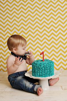 First birthday cake smash -- Love the background and little man's outfit.