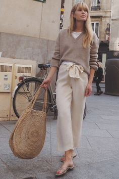 Jeanette Madsen wearing a tan sweater, a white t-shirt, beige crop trousers, nud… – comfy travel outfit summer Beige Pullover, Pullover Outfit, Comfy Travel Outfit, Travel Outfit Summer, Comfy Outfit, Travel Outfits, Beige Outfit, Neutral Outfit, Neutral Style