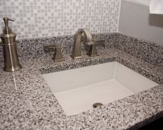 Snow & Ice Bathroom, Pepper Granite vanity countertop with undermount rectangular sinks. Delta Dryden Faucets in Stainless Steel. Snow & Ice Mosaic backsplash.  By J.T. McDermott Remodeling.