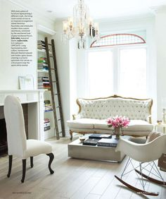 white + glam.  love the built-in shelves - they're located exactly where we have a blank spot (between fireplace and window) in the living room.