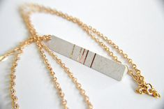 This is a modern and youthful necklace made of a special jewelry concrete which has a shiny and very smooth surface.  It is decorated with shiny gold a brown stripes and has a 70 cm long chain.  Total weight: 5-6 gramm  Unique requests are welcome, so do not hesitate to contact me to create