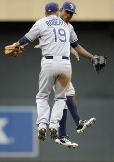 B.J. Upton #2 and Ryan Roberts #19 of the Tampa Bay Rays celebrate a win against the Minnesota Twins on August 12, 2012