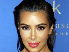 Kim Kardashian Resurfaces To Spread Some Sexy Holiday Cheer
