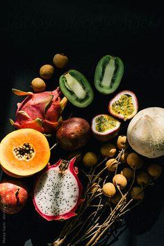 Tropical Fruits on Dark Background by marija   Stocksy United