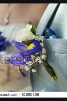 Iris and white rose boutonniere.