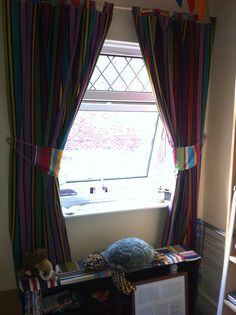 Curtains in green, blue, lilac, purple, red and yellow all separated by thin black stripes Roman Blinds, Curtains With Blinds, Bold Stripes, Stripes Design, Beautiful Blinds, Lilac, Purple, Blue, How To Make Curtains