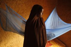 Zali Idy, 12, poses in her bedroom in the remote village of Hawkantaki, Niger. Zali was married in 2011. In January 2012, soon after she turned 12, she was carried on a bullock cart to her 23-year-old husband's home.