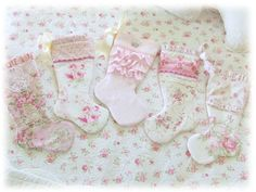 If you keep clicking on the picture, eventually you will come to a boutique that makes these.  They are expensive but there are tons of ideas.  You can make them yourself. Make a stocking pattern and continue from there with the decorations.  The trick is to get vintage material that is soft and pretty with lots of lace and thin ribbon.  Tiny buttons, too.
