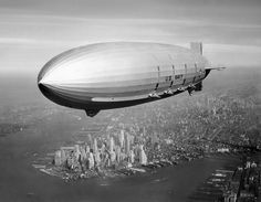 """The USS Macon was a naval """"flying air craft carrier"""" and scout aerostat. It crashed into the Pacific Ocean during a storm in 1935. Here it is, floating above NYC in 1933."""