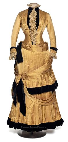 Dress in 2 pieces, Chauvet, ca. 1884–86. Yellow silk taffeta with black trim and lace. Photo: Jean Tholance. Les Arts Décoratifs via Europeana Fashion