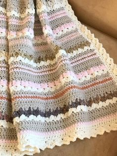 This is a special blanket for me because it was designed for my first grandchild. I wanted something a little bit rustic, with some texture, yet sweet and soft. It was fun to add the color-changing earthy yarn to give it a bit of artistic interest. This multi-color yarn, which