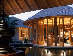 big round gazebo with stone bridge, sliding glass doors, vaulted wooden ceiling, office room inside of The Exquisite Kind of Gazebo for Your House Round Gazebo, Outdoor Spaces, Outdoor Living, Pergola, Beach House Furniture, Slider Door, Style Rustique, Southern House Plans, Wooden Ceilings