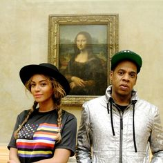 """Beyonce and Jay Z -- """"Le couple star vole la vedette à la Joconde lors d'une visite au Louvre !"""" [Not entirely sure I agree with the sentiment, but it says """"The star pair steals the show at the Mona Lisa during a visit to the Louvre!""""]  The couple and daughter had a private tour of the Louvre in October of 2014. See more of their tour, and some pretty cute Blue Ivy photos, here: http://www.mtv.com/news/1961087/blue-ivy-beyonce-jay-z-louvre-paris-photos/"""